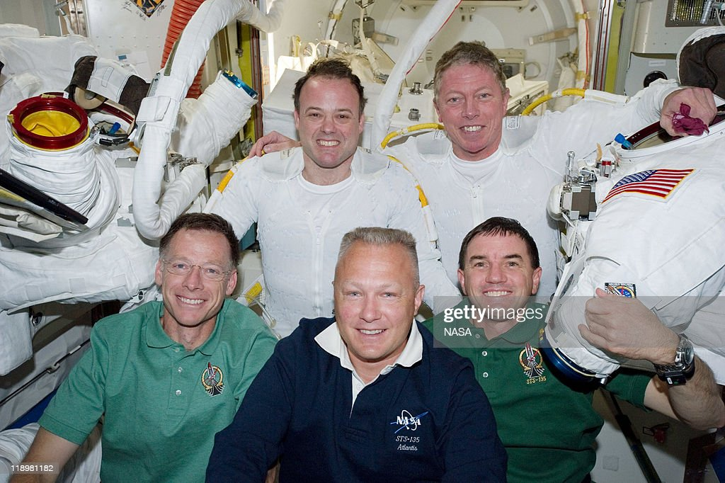 In this handout image provided by the National Aeronautics and Space Administration (NASA), NASA astronauts Ron Garan (top left) and Mike Fossum (top right), from left front, NASA astronauts Chris Ferguson, STS-135 commander, Doug Hurley, pilot, and Rex Walheim, mission specialists pose for photographs in the Quest airlock of the International Space Station following a six-and-a-half-hour spacewalk July 12, 2011 in space. This was the 160th spacewalk devoted to station assembly and maintenance since construction began in 1998. Space shuttle Atlantis has embarked on a 12-day mission to the International Space Station where it will deliver the Raffaello multi-purpose logistics module packed with supplies and spare parts. This will be the final launch of the space shuttle program, which began on April 12, 1981 with the launch of Colombia.