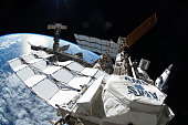 In this handout image provided by the National Aeronautics and Space Administration space shuttle Atlantis remains docked to the International Space...