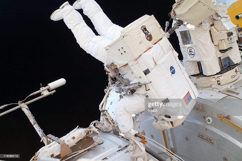 In this handout image provided by the National Aeronautics and Space Administration (NASA), NASA astronaut Ronald Garan works in the International Space Station's Quest airlock prior to a planned six-and-a-half-hour spacewalk July 12, 2011 in space. This is the 160th spacewalk devoted to station assembly and maintenance since construction began in 1998. Space shuttle Atlantis has embarked on a 12-day mission to the International Space Station where it will deliver the Raffaello multi-purpose logistics module packed with supplies and spare parts. This was the final mission of the space shuttle program, which began on April 12, 1981 with the launch of Colombia.