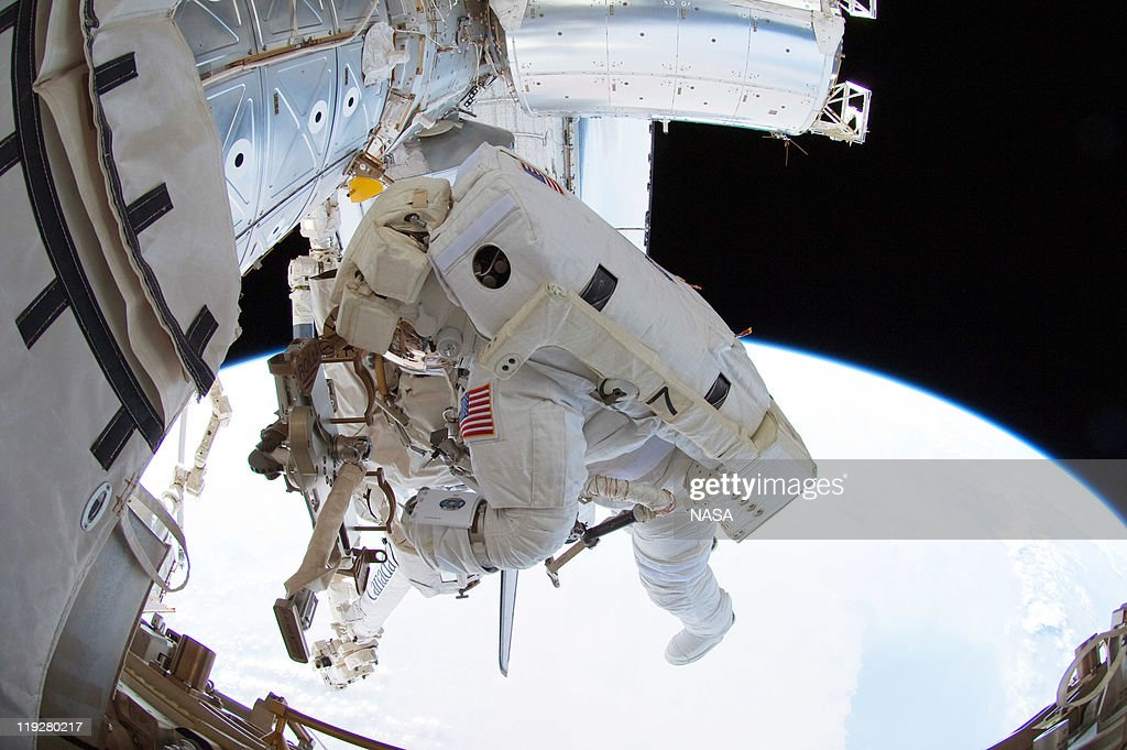 In this handout image provided by the National Aeronautics and Space Administration (NASA), NASA astronaut Ron Garan, Expedition 28 flight engineer, uses a tether to secure his position during a spacewalk he performed outside the docked International Space Station and space shuttle Atlantis July 12, 2011 in space. This is the 160th spacewalk devoted to station assembly and maintenance since construction began in 1998. Space shuttle Atlantis has embarked on a 12-day mission to the International Space Station where it will deliver the Raffaello multi-purpose logistics module packed with supplies and spare parts. This was the final mission of the space shuttle program, which began on April 12, 1981 with the launch of Colombia.