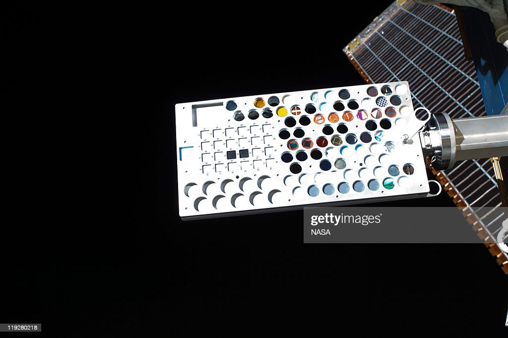 In this handout image provided by the National Aeronautics and Space Administration (NASA), the Materials on International Space Station Experiment - 8 (MISSE-8) photographed during a planned six-and-a-half-hour spacewalk July 12, 2011 in space. The experiment package is a test bed for materials and computing elements attached to the outside of the orbiting complex. These materials and computing elements are being evaluated for the effects of atomic oxygen, ultraviolet, direct sunlight, radiation, and extremes of heat and cold. This experiment allows the development and testing of new materials and computing elements that can better withstand the rigors of space environments. Results will provide a better understanding of the durability of various materials and computing elements when they are exposed to the space environment, with applications in the design of future spacecraft. Space shuttle Atlantis has embarked on a 12-day mission to the International Space Station where it will deliver the Raffaello multi-purpose logistics module packed with supplies and spare parts. This was the final mission of the space shuttle program, which began on April 12, 1981 with the launch of Colombia.