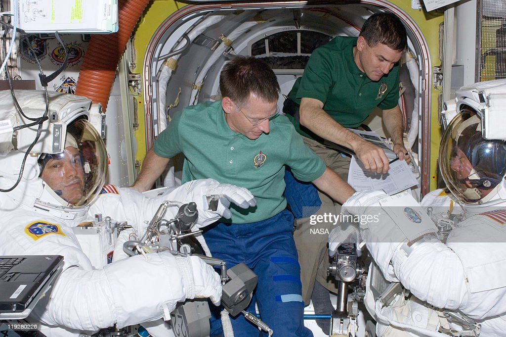 In this handout image provided by the National Aeronautics and Space Administration (NASA), Wearing extravehicular mobility unit space suits, NASA astronauts Mike Fossum (right), and Ron Garan, both Expedition 28 flight engineers, are assisted by NASA astronauts Chris Ferguson (foreground) and Rex Walheim in the International Space Station's Quest airlock prior to the July 12 spacewalk during which Fossum and Garan egressed the orbiting complex to complete some needed chores July 12, 2011 in space. This is the 160th spacewalk devoted to station assembly and maintenance since construction began in 1998. Space shuttle Atlantis has embarked on a 12-day mission to the International Space Station where it will deliver the Raffaello multi-purpose logistics module packed with supplies and spare parts. This was the final mission of the space shuttle program, which began on April 12, 1981 with the launch of Colombia.