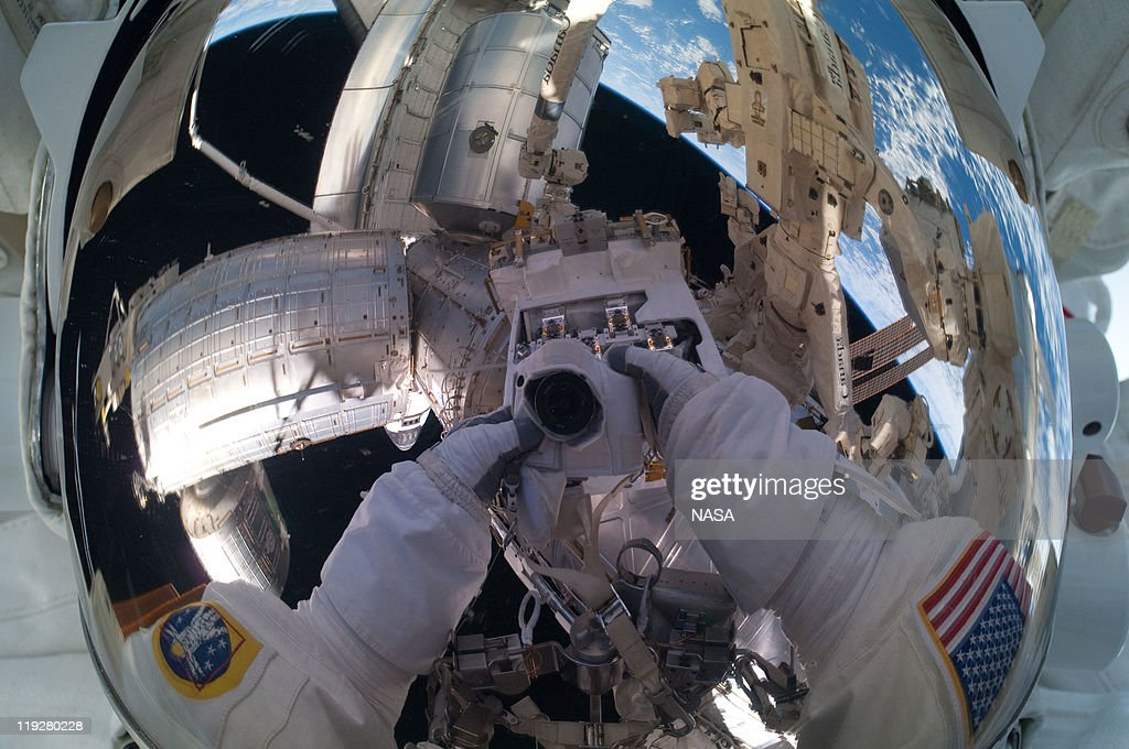 In this handout image provided by the National Aeronautics and Space Administration (NASA), NASA astronaut Mike Fossum, Expedition 28 flight engineer, makes a self portrait of himself through his helmet visor with the International Space Station in the background during a planned six-and-a-half-hour spacewalk July 12, 2011 in space. This is the 160th spacewalk devoted to station assembly and maintenance since construction began in 1998. Space shuttle Atlantis has embarked on a 12-day mission to the International Space Station where it will deliver the Raffaello multi-purpose logistics module packed with supplies and spare parts. This was the final mission of the space shuttle program, which began on April 12, 1981 with the launch of Colombia.