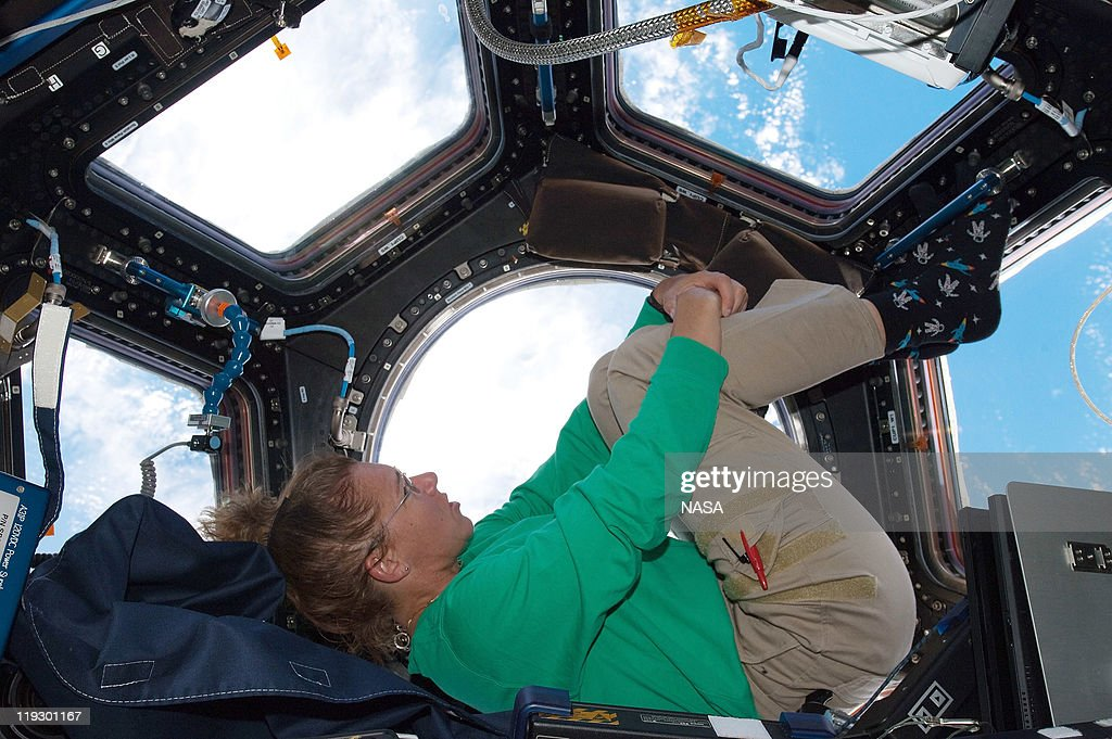 In this handout image provided by the National Aeronautics and Space Administration NASA astronaut Sandy Magnus mission specialist for space shuttle...