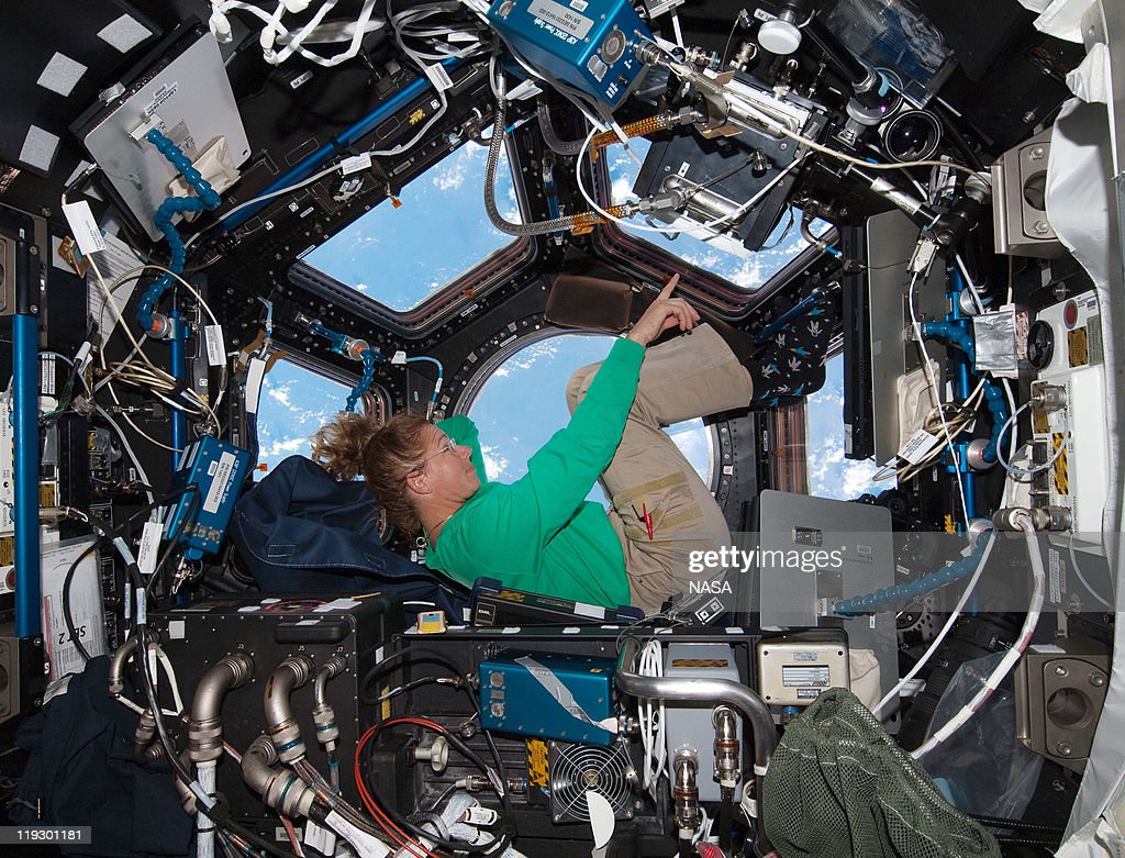 In this handout image provided by the National Aeronautics and Space Administration (NASA), NASA astronaut Sandy Magnus mission specialist for space shuttle Atlantis STS-135, takes in the view while sitting in the Cupola addition of the International Space Station July 16, 2011 in space. Space shuttle Atlantis is on the last leg of a 12-day mission to the International Space Station where it delivered the Raffaello multi-purpose logistics module packed with supplies and spare parts. This was the final mission of the space shuttle program, which began on April 12, 1981 with the launch of Colombia.