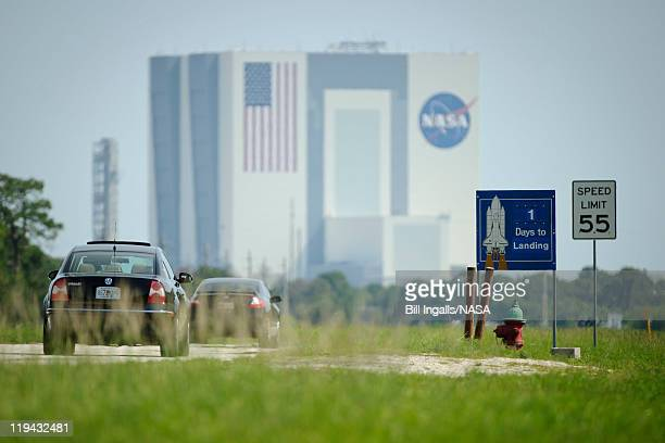 In this handout image provided by the National Aeronautics and Space Administration a sign along the road at the NASA Kennedy Space Center shows the...