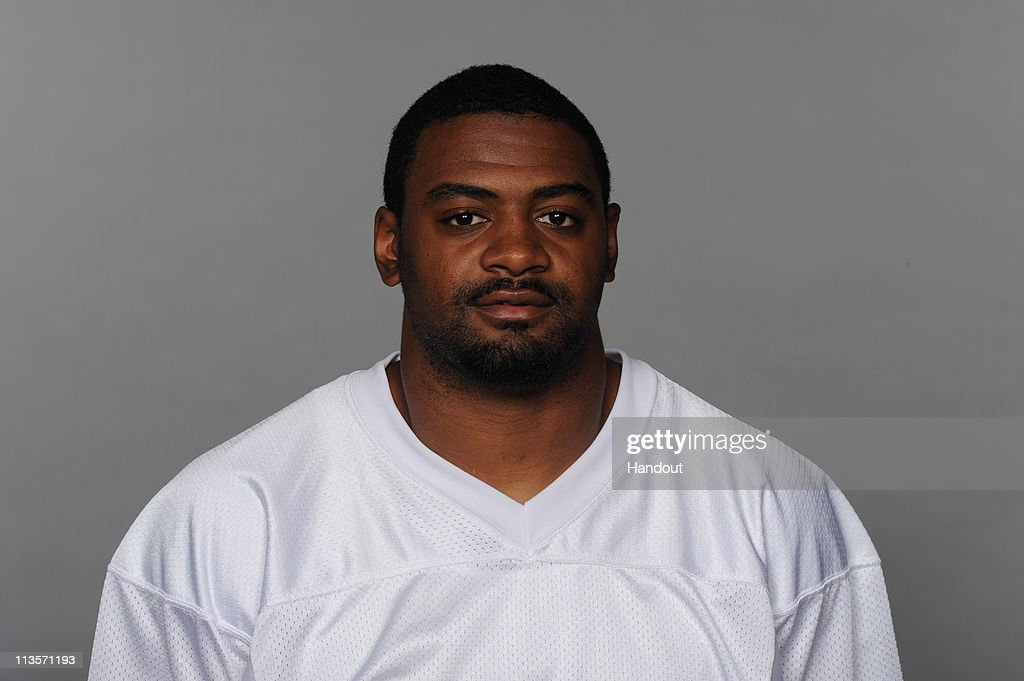 In this handout image provided by the NFL, <a gi-track='captionPersonalityLinkClicked' href=/galleries/search?phrase=Karlos+Dansby&family=editorial&specificpeople=233759 ng-click='$event.stopPropagation()'>Karlos Dansby</a> of the Miami Dolphins poses for his 2010 NFL headshot circa 2010 in Miami, Florida.