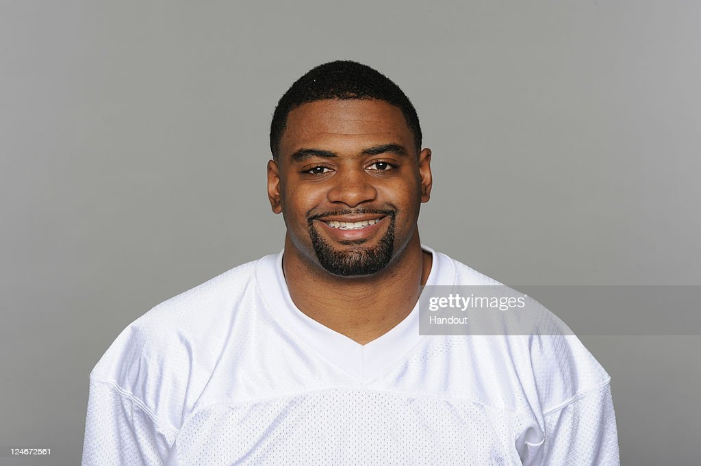 In this handout image provided by the NFL, <a gi-track='captionPersonalityLinkClicked' href=/galleries/search?phrase=Karlos+Dansby&family=editorial&specificpeople=233759 ng-click='$event.stopPropagation()'>Karlos Dansby</a> of the Miami Dolphins poses for his NFL headshot circa 2011 in Miami, Florida.