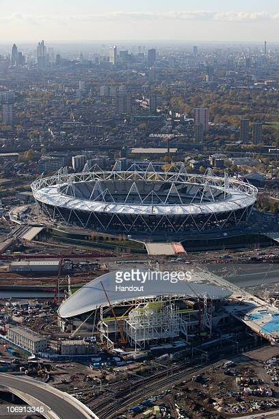 In this handout image provided by the Olympic Delivery Authority an aerial view reveals the Aquatics Centre sited in front of the Olympic Stadium of...
