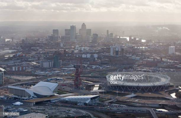 In this handout image provided by the Olympic Delivery Authority an aerial view looking south reveals a view of the Olympic Stadium the Aquatics...