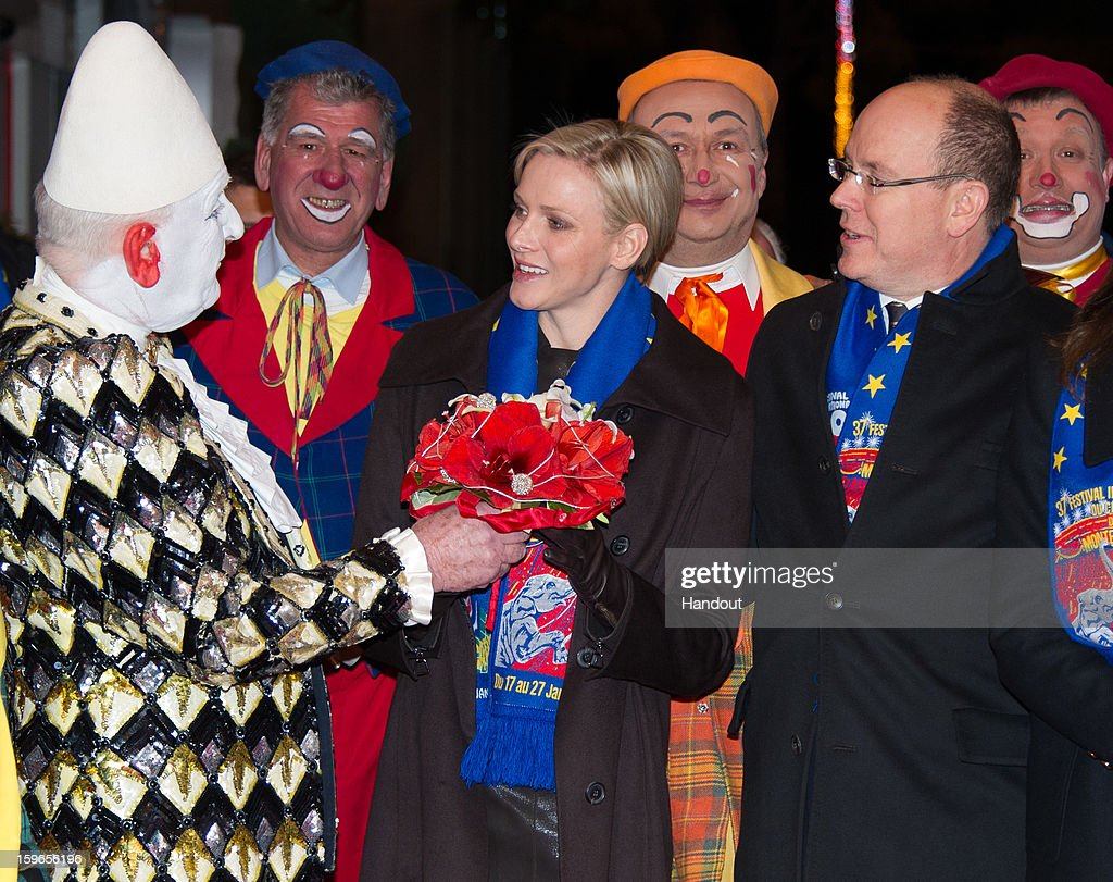 In this handout image provided by the Palais Princier de Monaco, Princess Charlene of Monaco and Prince Albert II of Monaco attend the opening of the Monte-Carlo 37th International Circus Festival on January 17, 2013 in Monte-Carlo, Monaco.