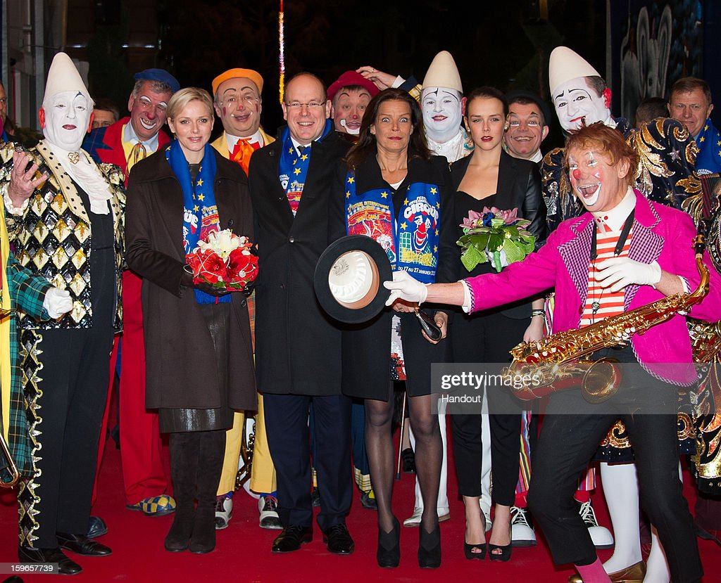In this handout image provided by the Palais Princier de Monaco, Princess Charlene of Monaco, Prince Albert II of Monaco, Princess Stephanie of Monaco and her daughter Pauline Ducruet attend the opening of the Monte-Carlo 37th International Circus Festival on January 17, 2013 in Monte-Carlo, Monaco.