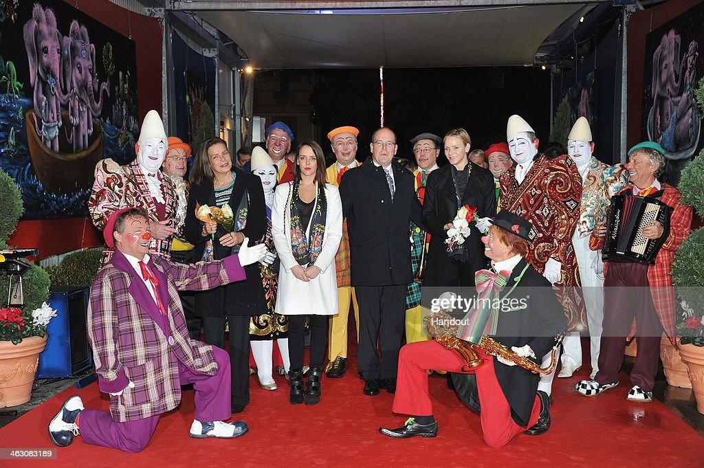 In this handout image provided by the Palais Princier de Monaco, (L-R) Princess Stephanie of Monaco, Pauline Ducruet, Prince Albert II of Monaco and Princess Charlene of Monaco attend the 38th International Circus Festival on January 16, 2014 in Monte-Carlo, Monaco.