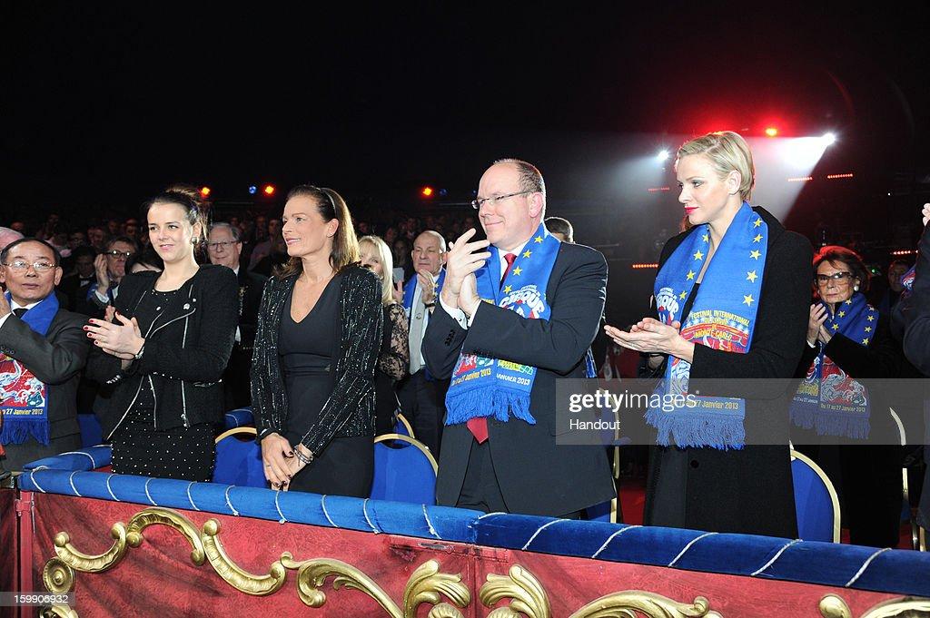 In this handout image provided by the Palais Princier de Monaco, Pauline Ducruet, Princess Stephanie of Monaco, Prince Albert II of Monaco and Princess Charlene of Monaco attend the Monte-Carlo 37th International Circus Festival Closing Ceremony on January 22, 2013 in Monte-Carlo, Monaco.