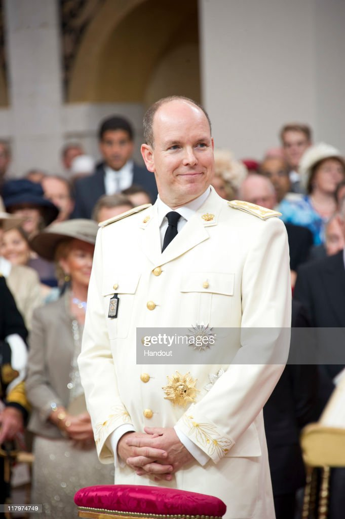 In this handout image provided by the Palais Princier, Prince Albert II of Monaco smiles during the religious ceremony of the Royal Wedding and his marriage to Princess Charlene of Monaco held in the main courtyard at Prince's Palace on July 2, 2011 in Monaco. The Roman-Catholic ceremony followed the civil wedding which was held in the Throne Room of the Prince's Palace of Monaco on July 1. With her marriage to the head of state of the Principality of Monaco, Charlene Wittstock has become Princess consort of Monaco and gains the title, Princess Charlene of Monaco. Celebrations including concerts and firework displays are being held across several days, attended by a guest list of global celebrities and heads of state.