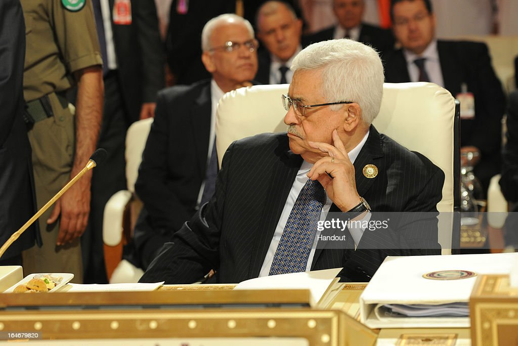 In this handout image provided by the Palestinian Presidents Office (PPO), Palestinian President <a gi-track='captionPersonalityLinkClicked' href=/galleries/search?phrase=Mahmoud+Abbas&family=editorial&specificpeople=176534 ng-click='$event.stopPropagation()'>Mahmoud Abbas</a> attends the 24th Arab summit on March 26, 2013 in Qatar. The heads of State arrived fot the summit today and were greeted by the Emir of Qatar, Hamad bin Khalifa Al Thani who is hosting the summit.