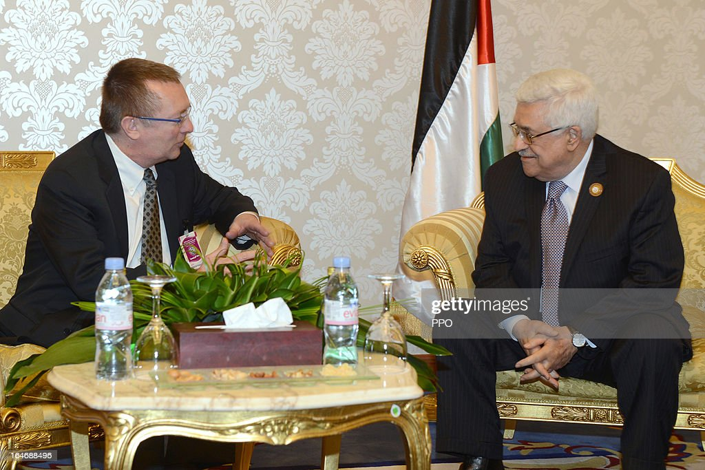 In this handout image provided by the Palestinian Presidents Office (PPO), Palestinian President Mahmoud Abbas (R) meets with Assistant Secretary-General of the United Nations for Political Affairs Jeffrey Feltman during the 24th Arab Summit on March 26, 2013 in Doha, Qatar. The heads of State arrived for the summit today and were greeted by the Emir of Qatar Hamad bin Khalifa Al Thani, who is hosting the summit.
