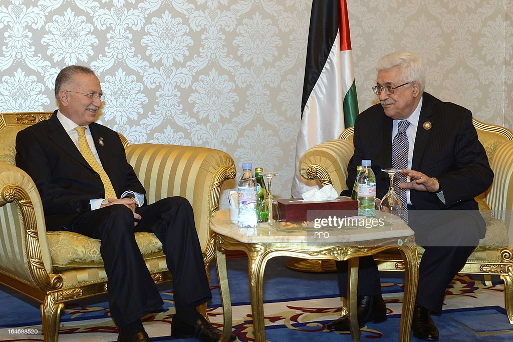 In this handout image provided by the Palestinian Presidents Office (PPO), Palestinian President <a gi-track='captionPersonalityLinkClicked' href=/galleries/search?phrase=Mahmoud+Abbas&family=editorial&specificpeople=176534 ng-click='$event.stopPropagation()'>Mahmoud Abbas</a> (R) meets with Secretary-General of the Organisation of Islamic Cooperation Ekmeleddin Ihsanoglu during the 24th Arab Summit on March 26, 2013 in Doha, Qatar. The heads of State arrived for the summit today and were greeted by the Emir of Qatar Hamad bin Khalifa Al Thani, who is hosting the summit.