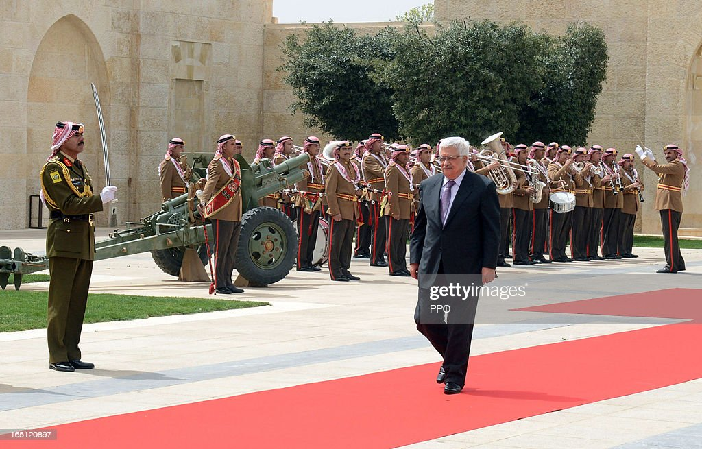 In this handout image provided by the Palestinian Presidents Office (PPO), Palestinian President Mahmoud Abbas arrives to meet his Majesty King Abdullah II to sign an agreement to defend Jerusalem and it's Islamic and Christian holy sites at The Royal Palace on March 31, 2013 in Amman, Jordan.