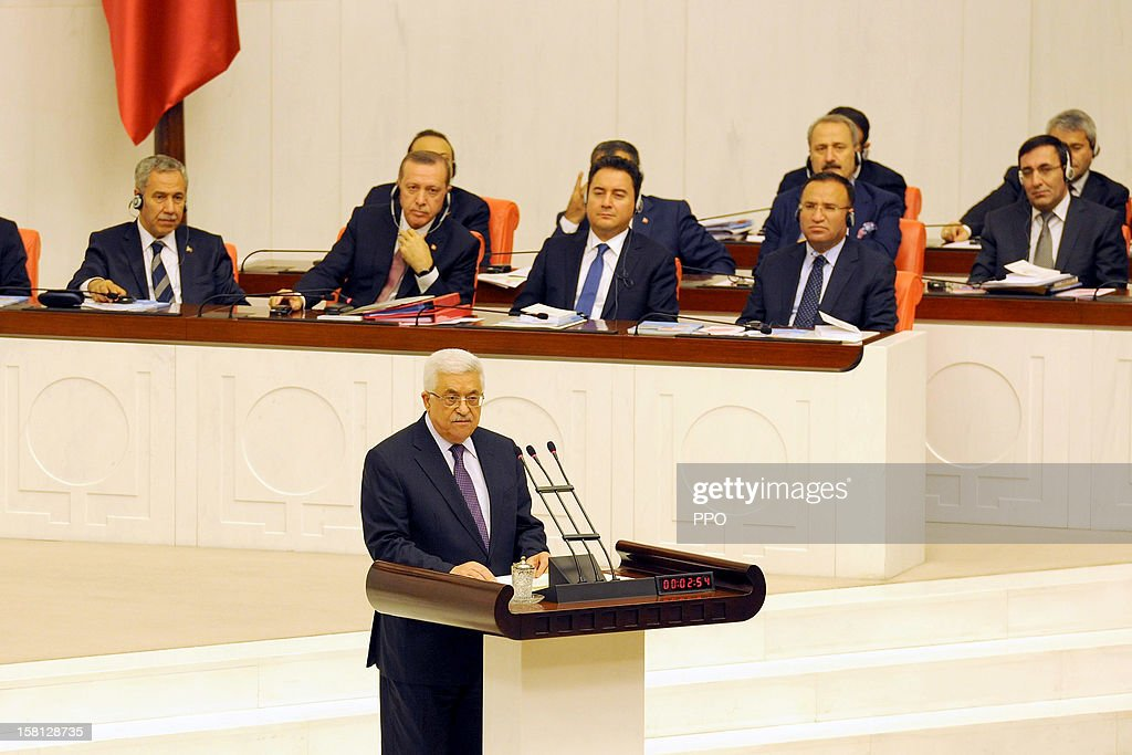 In this handout image provided by the Palestinian Press Office (PPO), Palestinian President <a gi-track='captionPersonalityLinkClicked' href=/galleries/search?phrase=Mahmoud+Abbas&family=editorial&specificpeople=176534 ng-click='$event.stopPropagation()'>Mahmoud Abbas</a> gives a speech to the Turkish Parliament December 10, 2012 in Ankara, Turkey. Abbas is on a three-day official visit during which he will meet with his Turkish counterpart President Abdullah Gul and Prime Minister Recep Erdogan and a number of Turkish senior officials.
