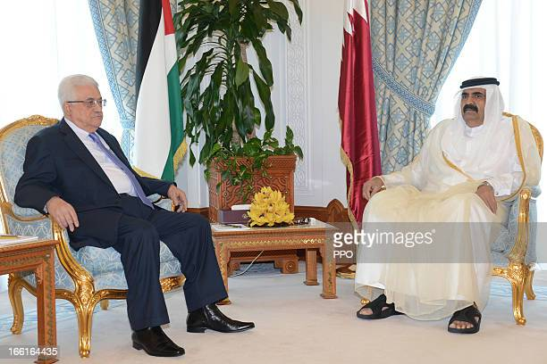 In this handout image provided by the Palestinian Press Office Palestinian President Mahmoud Abbas attends a meeting with the Emir of Qatar Sheikh...