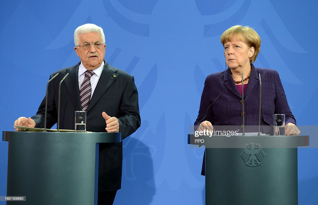 In this handout image provided by the Palestinian Press Office (PPO), German Chancellor <a gi-track='captionPersonalityLinkClicked' href=/galleries/search?phrase=Angela+Merkel&family=editorial&specificpeople=202161 ng-click='$event.stopPropagation()'>Angela Merkel</a> (R) and President of the Palestinian National Authority <a gi-track='captionPersonalityLinkClicked' href=/galleries/search?phrase=Mahmoud+Abbas&family=editorial&specificpeople=176534 ng-click='$event.stopPropagation()'>Mahmoud Abbas</a> speak to the media following talks at the Chancellery on October 18, 2013 in Berlin, Germany. Abbas is currently in Europe partly to lobby the European Union against providing Israel funds for housing expansion in occupied territories.