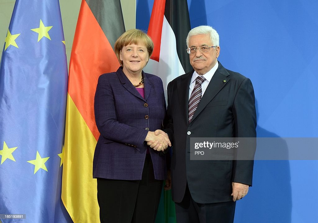 In this handout image provided by the Palestinian Press Office (PPO), German Chancellor Angela Merkel and President of the Palestinian National Authority Mahmoud Abbas shake hands after a press conference at the Chancellery on October 18, 2013 in Berlin, Germany. Abbas is currently in Europe partly to lobby the European Union against providing Israel funds for housing expansion in occupied territories.