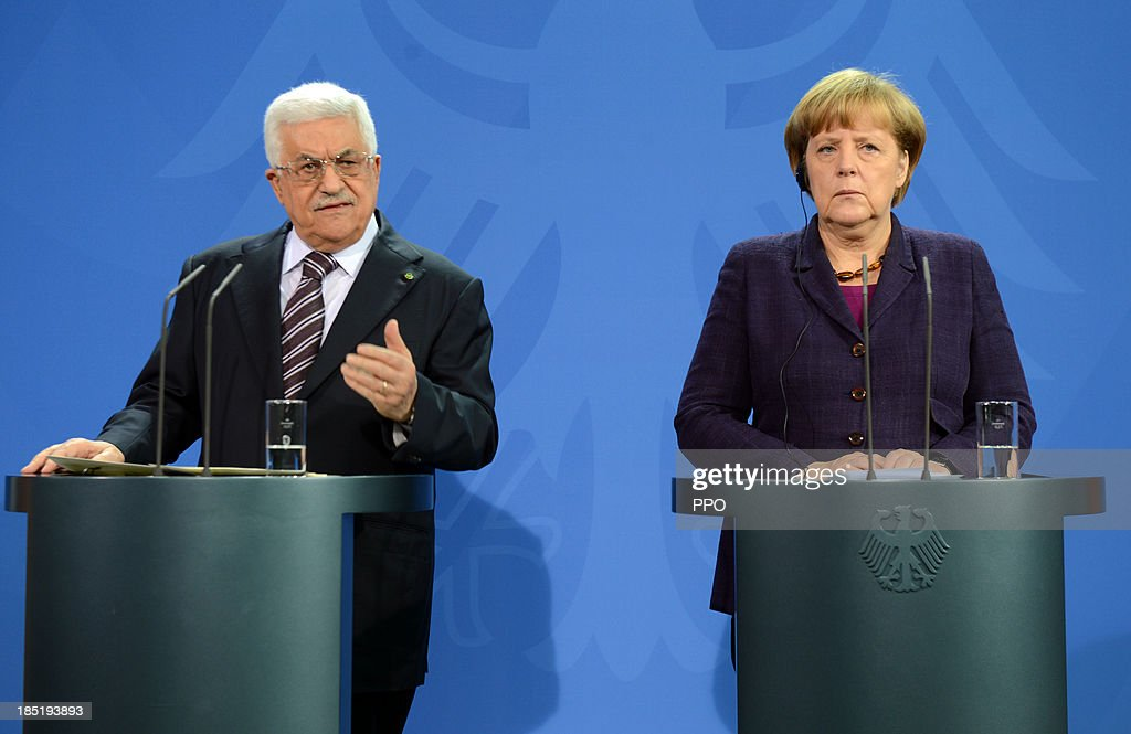 In this handout image provided by the Palestinian Press Office (PPO), German Chancellor Angela Merkel (R) and President of the Palestinian National Authority Mahmoud Abbas speak to the media following talks at the Chancellery on October 18, 2013 in Berlin, Germany. Abbas is currently in Europe partly to lobby the European Union against providing Israel funds for housing expansion in occupied territories.