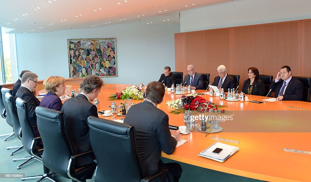 In this handout image provided by the Palestinian Press Office (PPO), German Chancellor Angela Merkel (C-L) and President of the Palestinian National Authority Mahmoud Abbas (C-R) attend a meeting at the Chancellery on October 18, 2013 in Berlin, Germany. Abbas is currently in Europe partly to lobby the European Union against providing Israel funds for housing expansion in occupied territories.