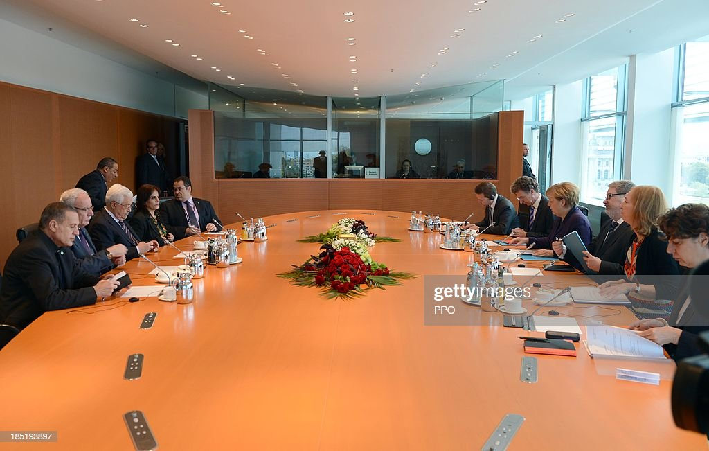 In this handout image provided by the Palestinian Press Office (PPO), German Chancellor Angela Merkel (C-R) and President of the Palestinian National Authority Mahmoud Abbas (C-L) attend a meeting at the Chancellery on October 18, 2013 in Berlin, Germany. Abbas is currently in Europe partly to lobby the European Union against providing Israel funds for housing expansion in occupied territories.