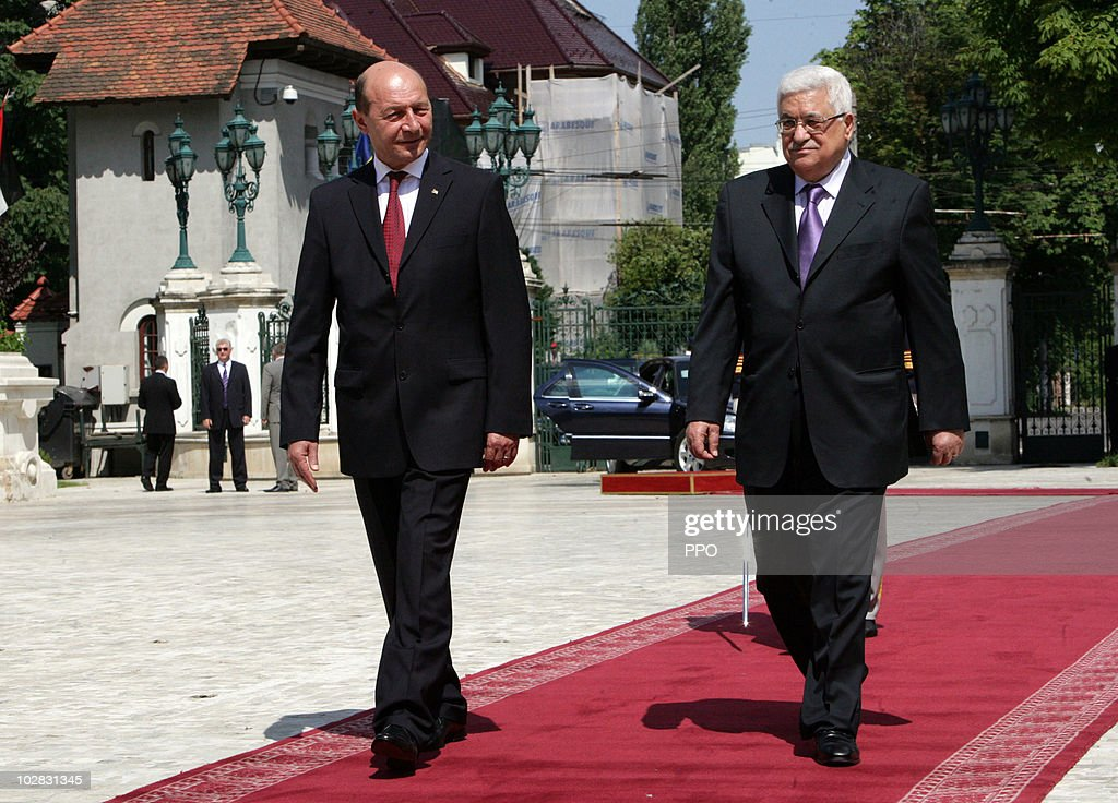 In this handout image provided by the Palestinian Press Office (PPO), President of Palestinian Authority Mahmud Abbas (R) meets with Romanian President <a gi-track='captionPersonalityLinkClicked' href=/galleries/search?phrase=Traian+Basescu&family=editorial&specificpeople=542324 ng-click='$event.stopPropagation()'>Traian Basescu</a> at the Cotroceni Palace, the Romanian Presidency headquarters July 12, 2010 in Bucharest, Romania. Abbas renewed calls for the Islamist Hamas movement to sign an Egyptian-drafted reconciliation document that would allow elections to take place.