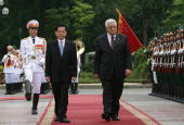 In this handout image provided by the Palestinian Press Office Vietnam's President Nguyen Minh Triet and Palestinian President Mahmoud Abbas walk...