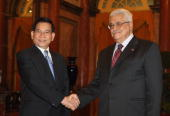 In this handout image provided by the Palestinian Press Office Vietnam's President Nguyen Minh Triet shakes hands with Palestinian President Mahmoud...
