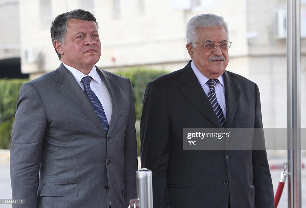 In this handout image provided by the Palestinian Press Office (PPO), Palestinian President Mahmoud Abbas (Abu Mazen) receives King Abdullah II of Jordan (L) during a welcoming ceremony on November 21, 2011 in Ramallah, West Bank. King Abdullah II of Jordan visited Ramallah for the first time since August 2000 to hold talks with the Palestinian President ahead of a summit due to be held between rival Palestinian movements Fatah and Hamas.