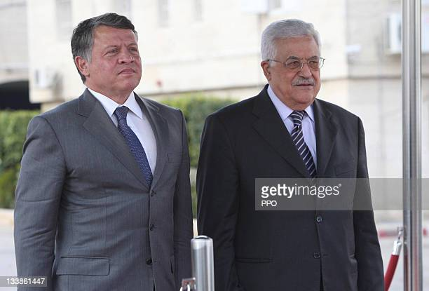 In this handout image provided by the Palestinian Press Office Palestinian President Mahmoud Abbas receives King Abdullah II of Jordan during a...