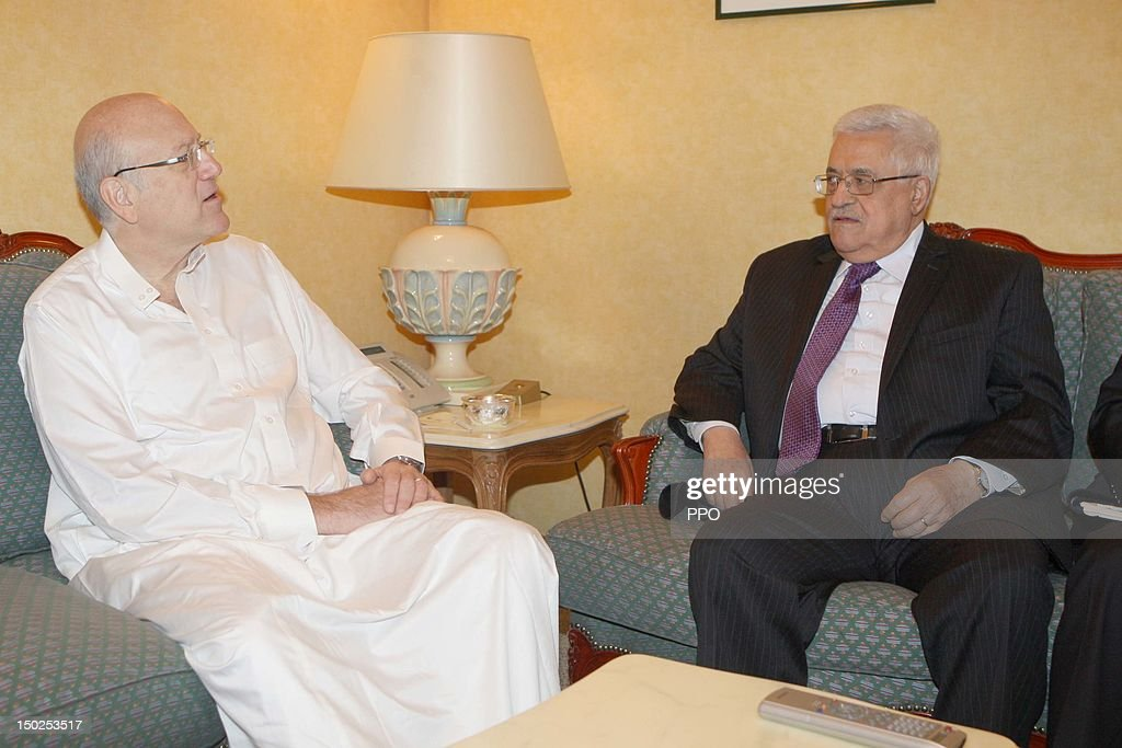 In this handout image provided by the Palestinian Press Office (PPO), Palestinian President Mahmoud Abbas (Abu Mazen) meets with Lebanese Prime Minister <a gi-track='captionPersonalityLinkClicked' href=/galleries/search?phrase=Najib+Mikati&family=editorial&specificpeople=2466031 ng-click='$event.stopPropagation()'>Najib Mikati</a> on August 12, 2012 in Mecca, Saudi Arabia. The leaders met ahead of the Organization of Islamic Countries (OIC) two-day summit in Mecca, set to start on Tuesday.