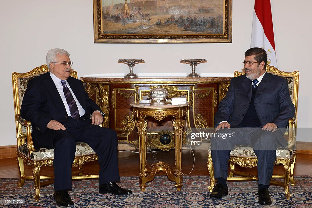 In this handout image provided by the Palestinian Press Office (PPO), Palestinian President Mahmoud Abbas (L) meets with Egyptian President <a gi-track='captionPersonalityLinkClicked' href=/galleries/search?phrase=Mohamed+Morsi&family=editorial&specificpeople=7484676 ng-click='$event.stopPropagation()'>Mohamed Morsi</a> January 9, 2013 in Cairo, Egypt. Morsi was also set to meet with Hamas leader Khaled Mashaal, the rival of Fatah leader Abbas.