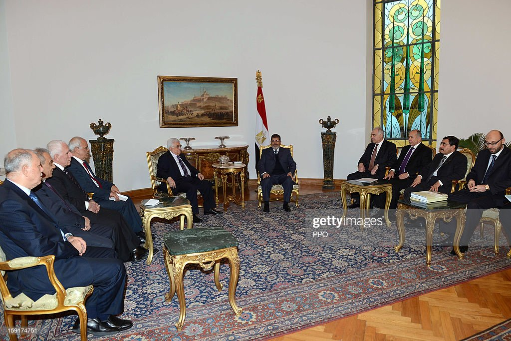 In this handout image provided by the Palestinian Press Office (PPO), Palestinian President Mahmoud Abbas (5L) meets with Egyptian President <a gi-track='captionPersonalityLinkClicked' href=/galleries/search?phrase=Mohamed+Morsi&family=editorial&specificpeople=7484676 ng-click='$event.stopPropagation()'>Mohamed Morsi</a> (5R) January 9, 2013 in Cairo, Egypt. Morsi was also set to meet with Hamas leader Khaled Mashaal, the rival of Fatah leader Abbas.