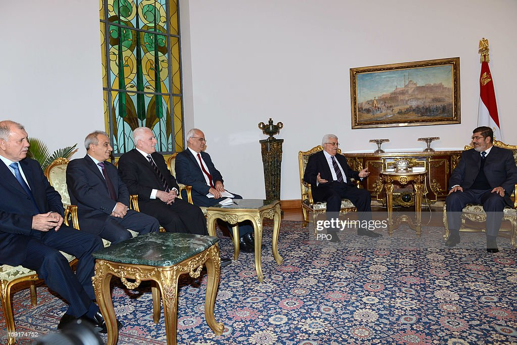 In this handout image provided by the Palestinian Press Office (PPO), Palestinian President Mahmoud Abbas (2R) meets with Egyptian President <a gi-track='captionPersonalityLinkClicked' href=/galleries/search?phrase=Mohamed+Morsi&family=editorial&specificpeople=7484676 ng-click='$event.stopPropagation()'>Mohamed Morsi</a> (R) January 9, 2013 in Cairo, Egypt. Morsi was also set to meet with Hamas leader Khaled Mashaal, the rival of Fatah leader Abbas.