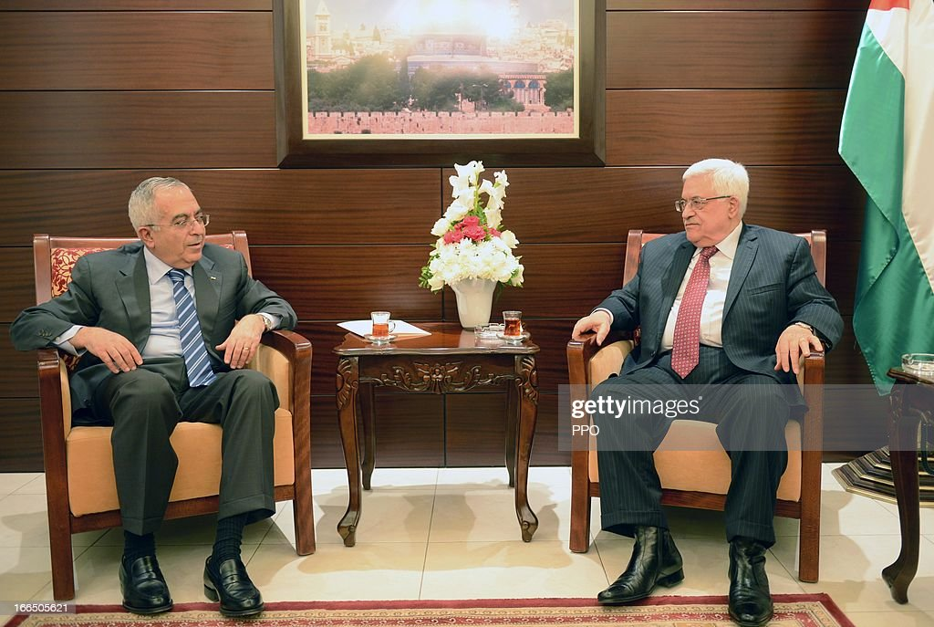 In this handout image provided by the Palestinian Press Office (PPO), Palestinian President Mahmoud Abbas President Mahmoud Abbas (R) accepts the resignation of Prime Minister Salam Fayyad during a meeting on April 13, 2013 in Ramallah, West Bank. Despite pressure from the U.S. and Europe, Abbas accepted the resignation because of tensions between the two.