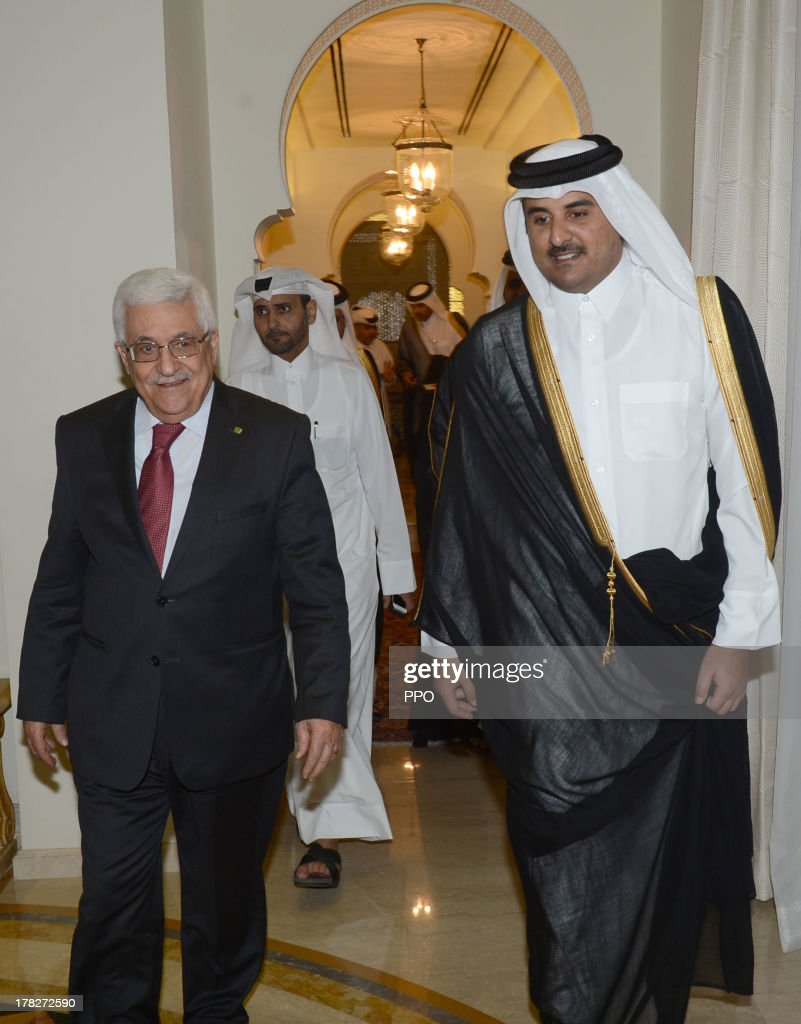 In this handout image provided by the Palestinian Press Office (PPO), Palestinian President <a gi-track='captionPersonalityLinkClicked' href=/galleries/search?phrase=Mahmoud+Abbas&family=editorial&specificpeople=176534 ng-click='$event.stopPropagation()'>Mahmoud Abbas</a> (L) meets with Prince Tamim bin Hamad al-Thani, the Emir of Qatar, August 28, 2013 in Doha, Qatar. Abbas also visited Jordan today to discuss the ongoing crisis in Syria with King Abdullah II.