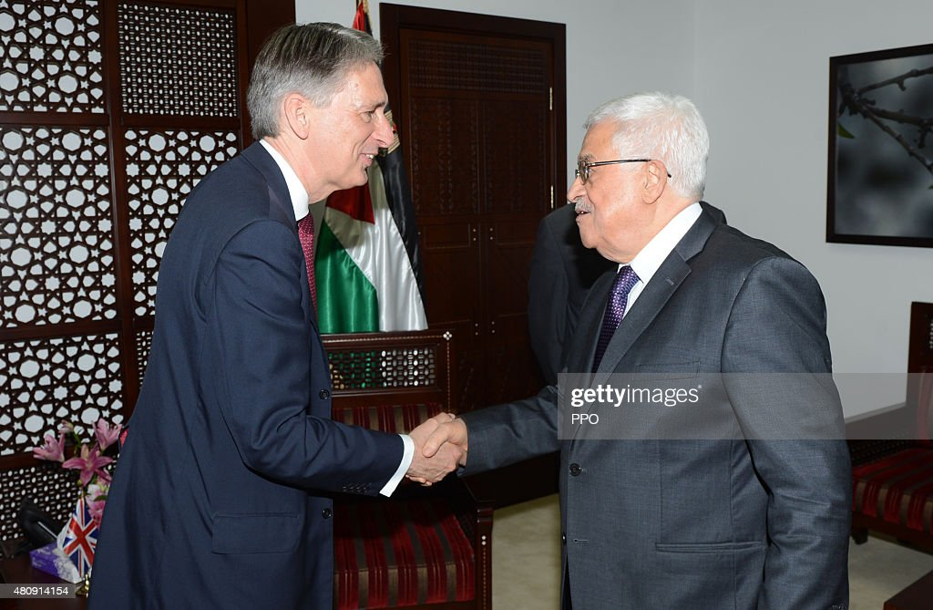 In this handout image provided by the Palestinian Press Office (PPO), British Foreign Secretary Philip Hammond shakes hands with Palestinian President Mahmoud Abbas during a meeting on July 16, 2015 in Ramallah, West Bank.