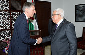 In this handout image provided by the Palestinian Press Office British Foreign Secretary Philip Hammond shakes hands with Palestinian President...