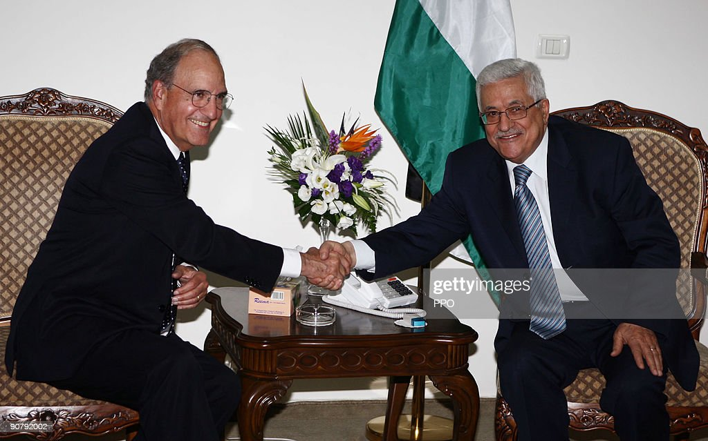 In this handout image provided by the Palestinian Press Office (PPO), US Senator George Mitchell is greeted by Palestinian President Mahmoud Abbas during a diplomatic trip on September 15, 2009 in Ramallah, West Bank. Mitchell, the US Middle East envoy is in the region to discuss diplomatic agreements over Jewish settlements in the West bank.