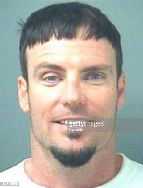 In this handout image provided by the Palm Beach County Sheriff's Office rapper Vanilla Ice whose real name is Robert Van Winkle poses for his mug...