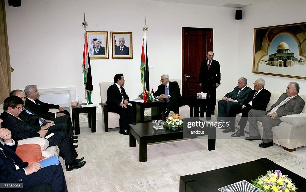 In this handout image provided by the PPO (Palestinian Press Office), Palestinian President Mahmoud Abbas (C,R) greets Turkish Foreign Minister Ali Babajanat his office on October 8, 2007 in Ramallah, West Bank. Turkey have recently been in discussion with Syria to agree that they will not allow Israel to use its airspace to strike Syria.