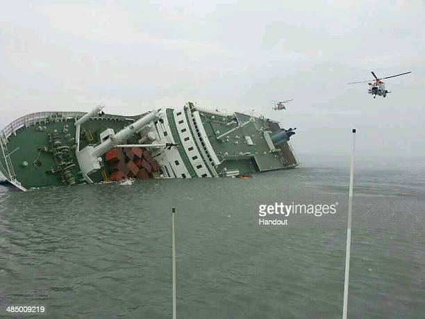 In this handout image provided by the Republic of Korea Coast Guard a passenger ferry sinks off the coast of Jindo Island on April 16 2014 in...