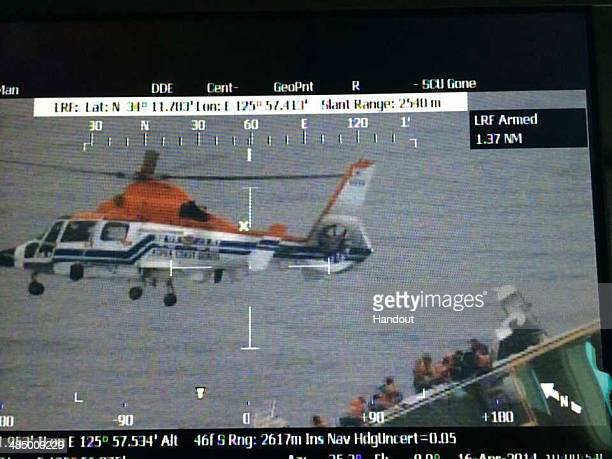 In this handout image provided by the Republic of Korea Coast Guard rescue work by members of the Republic of Korea Coast Guard continues around the...