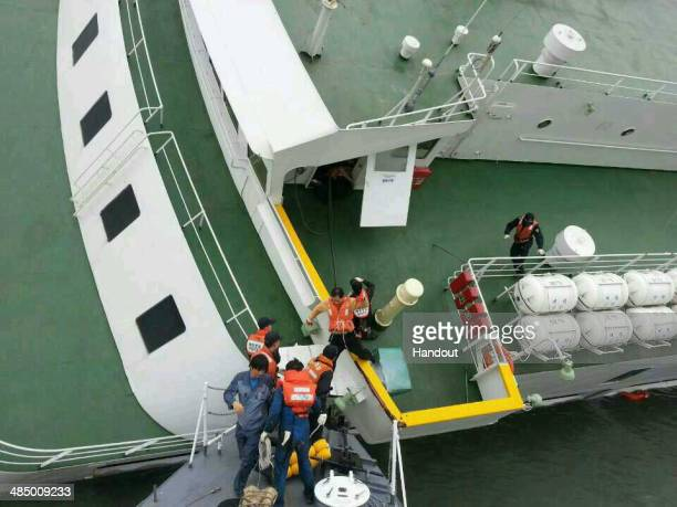 In this handout image provided by the Republic of Korea Coast Guard passengers are rescued by the Republic of Korea Coast Guard from a ferry sinking...