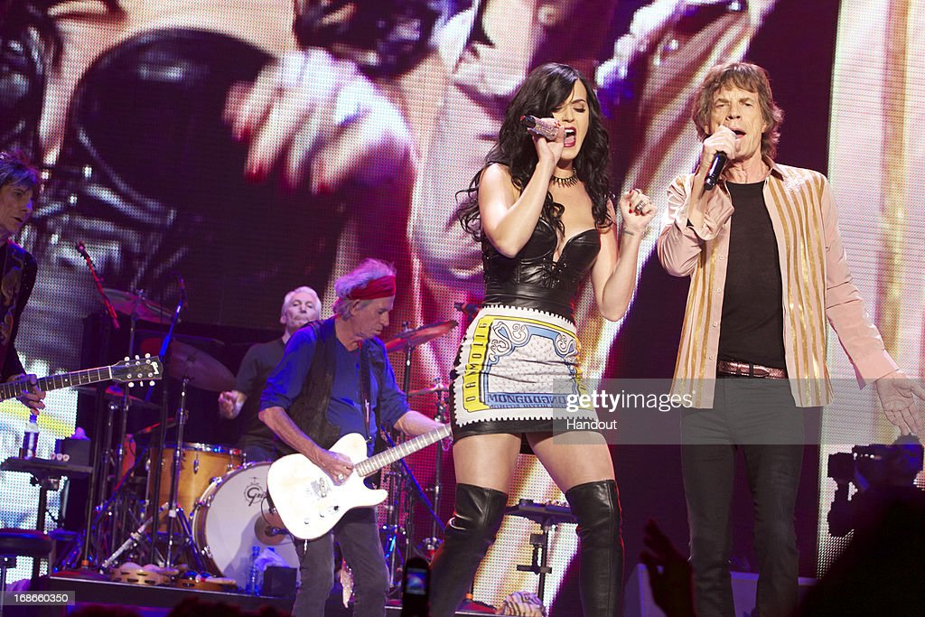In this handout image provided by The Rolling Stones, Katy Perry performs 'Beast of Burden' onstage with Mick Jagger during The Rolling Stones '50 and Counting' tour on May 11, 2013 in Las Vegas, Nevada.